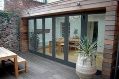 Wood Framed Doors, Bi Fold, Large Sliding Door, And Sliding Folding Door - Contemporary Exterior By Moon Design + Build