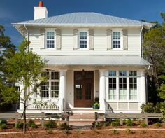Siding: Sherwin Williams 7050 Useful Gray. Exterior Trim Benjamin Moore White Dove. Gray Shutters: Sherwin Williams 7052 Gray Area. Shutters are Spanish Cedar. Columns are Kiln dried wood. Front door is made of Cypress wood. Color: Cabot #Spanish Moss, Semi- Transparent. Roofing is Galvallume 5-V. Color: Natural.