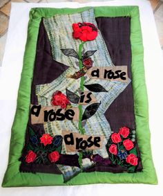 "..""A Rose is a Rose..is a Rose.."" composite wallhanging, patchwork /appliqué on raffia backgound with silk frame..."