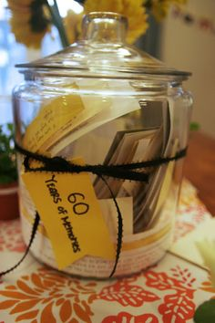 Wonderful idea for a 60th birthday party gift.  Guests provided memories to the party host in advance of the party.  All memories were put on a piece of paper and placed in a jar.
