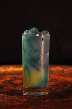 Electric Smurf- with Malibu coconut rum, Blue Curacao liqueur, Sprite soda and pineapple juice.
