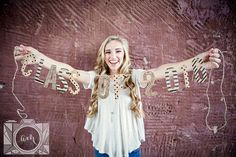 Holding class of 2016 banner senior pictures in downtown knoxville by Amanda May Photos