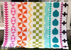 Sewing a quilt has never been more exciting than with this Coolest Ever Rainbow Quilt.