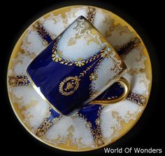 Blue and gold tea cup and saucer