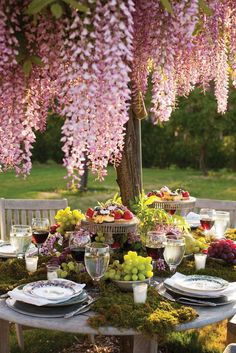 Abundance is key to a P. Allen Smith's tablescape, layered with moss, bowls of grapes and cakestands of different heights to create a dynamic look for his al fresco luncheon.Via Ay Mag