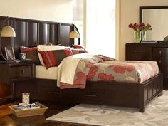 dark wood with red in master bedroom. Warm cream sheets and wall colors instead of cool white.