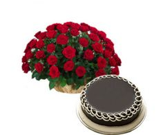 A basket arrangement of 50 red roses with seasonal fillers along with 1 kg chocolate cake.