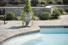 The landscaping around the swimming pool, the retaining wall and the landscape lighting are all part of the swimming pool design.
