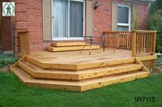 Low, medium size, single level deck with a cedar railing (#1R7115). --- reverse left and right sides and get rid of stairs near door, simply make flush