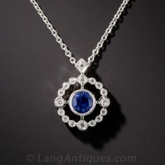 Sweet and petite, newly made in bright 14K white gold, a bright blue collet-set sapphire glistens in the center of a sparkling, diamond-set, compass motif frame. 3/8 inch diameter, 1/2 inch with bail, 16 inch chain.