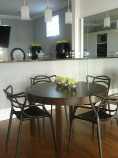 Kitchen diner with black kartell Master chairs