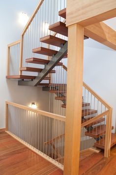 Mono stringer stairs with floating wood treads.