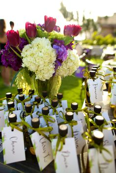 Beautifully bottled truffle-infused olive oil and balsamic vinegar doubled as both favors and escort cards. Photo: Anna Kim Photography