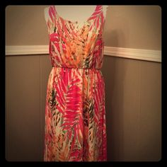 """Sonoma Palm Print Maxi Blouson Sonoma Palm Print Maxi Blouson Pink Orange Tropical Cruise Boho. Great for a summer day. All measurements are approximate and taken with garment laying flat, seam to seam  Bust:19"""" Waist: 13-19"""" Hips: 25"""" Length: 59½"""" from shoulder  Fabric: 33%Rayon, 62% Polyester, 5% Spandex Color: Pink/Orange/Green/White Sonoma Dresses Maxi"""