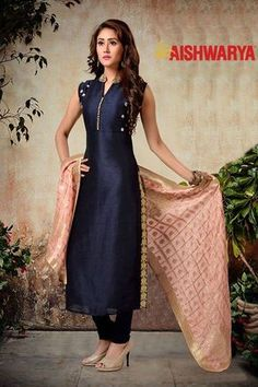 This dress with light work will look great for a casual night do. Buy Suit online - http://www.aishwaryadesignstudio.com/elegant-navy-blue-glossy-designer-suit