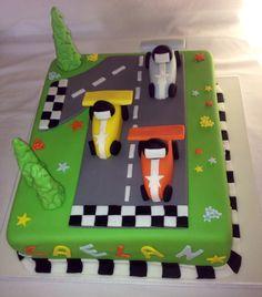 Cute boy's birthday cake with race cars