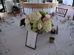 Gorgeous floral centerpiece for an outdoor wedding dinner and reception at the Historic Stranahan House Museum