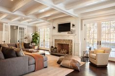 A stylish Colonial home with traditional interiors was designed for family living by Garrison Hullinger Interior Design, located in New Canaan, Connecticut.