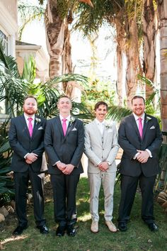 Mix-and-match! Love the groom's light gray suit against the dark suits of the groomsmen - and those fuschia ties! {@wturnerphoto}