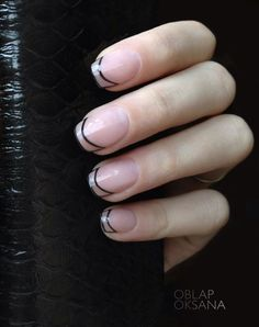 Trendy tips! This French manicure has a clear nail polish used as base and played around with shaping the French tip instead of filling it in. the black polish shaping the tips of the nails looks perfectly on point.