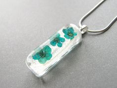 Turquoise Pressed Flower Necklace Real Flower by WishesontheWind, £15.50