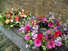 2 x beautiful colourful sympathy wreaths...funeral flowers don't have to be white, they can be vibrant & cheerful & reflect the personality of the person...they should be a fitting tribute