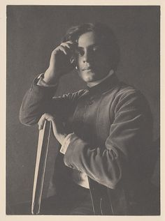 Kahlil Gibran with Book, 1896. F. Holland Day. Platinum print, 16.0 x 11.8 cm. Day interested in the education of underprivileged youth throughout his life, Day funded and guided the education of the young Lebanese immigrant Kahlil Gibran, encouraging him to study William Blake's drawings and to read Walt Whitman and Maurice Maeterlinck. Gibran, depicted here at age fourteen, developed into one of the twentieth century's most widely read poets, best known for his 1923 book The Prophet.