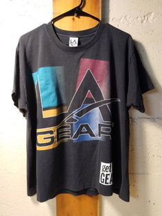 a4a95d14853 1990 s LA Gear T-Shirt Get In Gear Vintage 90 s Tee Black One Size Fits All  Faded Sports Shirt BODYGEAR