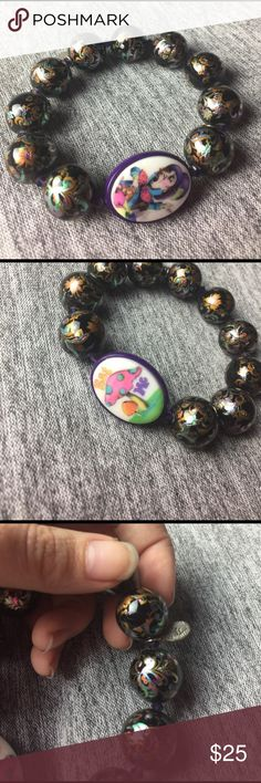 """Mad Hatter Bracelet This mad Hatter bracelet from Tarina Tarantino is so fun and a great statement piece! A double sided pendant with """"eat me"""" on one side and the mad Hatter on the other is so fun! Tarina Tarantino Jewelry Necklaces"""