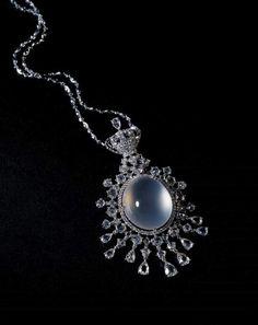 Colourless icy jadeite pendant necklace with diamonds.
