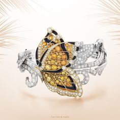 "Van Cleef & Arpels ""45 years in Beverly Hills"" exhibition until March 2. Enchanted by the endless transformations of flora and fauna, the Maison celebrates the delicate flutter of a butterfly's wings with the 2014 Autumn bracelet - gold, onyx, orange garnets, yellow sapphires and diamonds - transformable into a clip and bracelet. #45YearsinBeverlyHills"