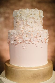 Blush two-tier cake with sugar flowers and gold accents. Filigree Cakes. Photography: Caroline Tran - www.carolinetran.net: Blush rose gold and peach wedding Colours { sophisticated and beautiful, elegant colours } http://www.fabmood.com/blush-rose-gold-elegant-colours #rosegold #elegant