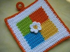 Although we love the bright colors used for this crochet pattern, feel free to customize this Colored Squares Potholder to match your kitchen decor. Handle your hot dishes with care.