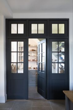 Pantry Room Entrance Door Yes Or No This Georgian Style Quot Joinery Wall Quot Of Dark Doors And Glass Separate The Pantry From The Kitchen But Creates A Very Elegant Feature Designed And Made By Humphrey Munson Best Kitchen Design, Kitchen Pantry Design, New Kitchen, Kitchen Ideas, Pantry Lighting, Dark Doors, Pantry Room, Kitchen Remodel Cost, Kitchen Doors