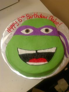 Ninja turtles cake. I could also make cupcakes with ninja turtle faces. Cheaper than buying a cake.