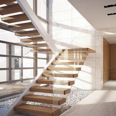 A modern u shape floating staircase, glass wall support wood treads, steel treads structure is hidden in wood box. Please contact us -Demax Staircase&Railing for free design. U Stairs Design, Staircase Glass Design, Staircase Design Modern, Glass Stairs, Floating Staircase, Modern Stairs, Cantilever Stairs, Staircase Railings, U Shaped Stairs