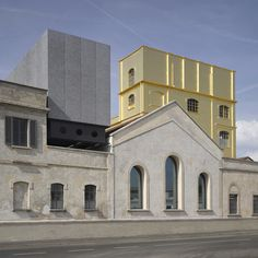 """Rem Koolhaas' firm has converted an old Milan distillery into a new arts centre for Fondazione Prada, featuring a """"haunted house"""" clad in 24-karat gold leaf"""