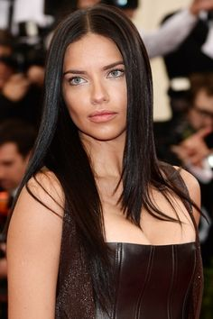 Adriana Lima tapped into spring/summer 2014's trend for poker-straight hair, pairing the style with natural-looking make-up.
