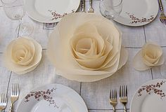 A simply elegant table with paper roses.  Perfect for a Mother's day lunch!