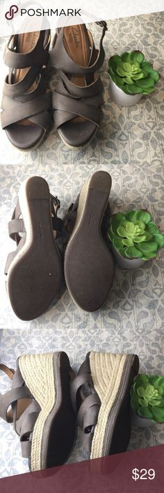 """Clarks  indigo leather strappy wedge sandal size 8 Nice pair of Clarks Indigo strappy wedge sandal size 8 leather is almost a grey with a hint of tan heel height 4"""" Clarks Shoes Wedges"""