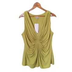 """KENNETH COLE Gathered Tank $69  Citron Green NEW KENNETH COLE Gathered Tank Top $69 Sz M Citron Green Stretch Shirt Medium   M1186  Dual layered design with a gathered starburst at center.  Fabulous.  Condition:  New, unworn condition; tags attached.  In my *opinion*, color is not true in photos. Actual garment has less mustard and more green tones than photos suggest. Measurements- Approximate, lying flat  (not doubled)   Unstretched Stretched  Underarm to underarm 19.5"""" 27""""  Lower hem…"""
