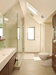 Remodel small bathroom with sloped ceiling attic bathroom remodel attic bathroom ideas sloped ceiling remodel small Small Attic Bathroom, Loft Bathroom, Narrow Bathroom, Bathroom Interior, Master Bathroom, Remodel Bathroom, Bathroom Fans, Skylight Bathroom, Bathroom Renovations