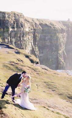 Sunset wedding portrait on the Cliffs of Moher: http://www.stylemepretty.com/little-black-book-blog/2016/03/17/ireland-sunset-inspired-wedding-inspiraton/ | Photography: Kay English - http://kayenglishphotography.com/