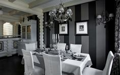 Shades of black, grey, silver and white make this diningroom dramatic