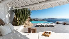 Perched above the Western coast in the Agia Sofia area, Villa Mariam is a stylish five bedroom home with an unobstructed sunset view. The panoramic sunset lounge opens to the infinity pool.  Its hilltop position offers a beautiful view of Mykonos Town, which is only a 6-minute drive away. • 5 bedrooms • Sleeps 10 guests •  #Mykonos#Greece#VisitGreece#Villa#VillaRental#Dream#Travel#Home#Weekend#Holiday#InteriorDesign#InstaTravel#Travelgram#Friday Porches, Mykonos Villas, Mykonos Town, Mykonos Greece, White Building, European Home Decor, Beautiful Villas, Dream House Exterior, Take Me Home