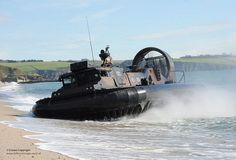 Picture shows a Royal Marine LCAC(LR) hovercraft landing on a beach during the Carlyon Bay Wader Exercise in Cornwall.