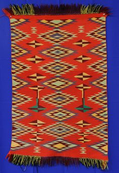Navajo Germantown Child's Blanket with fringe. This and more important Navajo textiles for sale on CuratorsEye.com