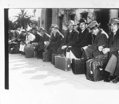 """On Their Way Out! -- Above photo show group of Japanese rounded up by FBI agents at Santa Barbara and dejectedly sitting with their baggage, awaiting removal for hearings in Los Angeles.""--caption on photograph :: Japanese American Relocation Digital Archive, 1941-1946"