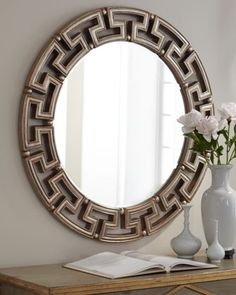 """Golden """"Greek Key"""" Mirror at Horchow.  Love this too.  Just measure and make sure it would fit, 40 inches diameter."""