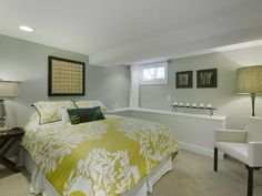 Exceptionnel Perfect Bedroom Design Tricks For Basement Bedrooms: Lovely Basement Bedroom  View With White Bed And Green Quilt Near The White Chair On Wide Carpet ~  SFXit ...